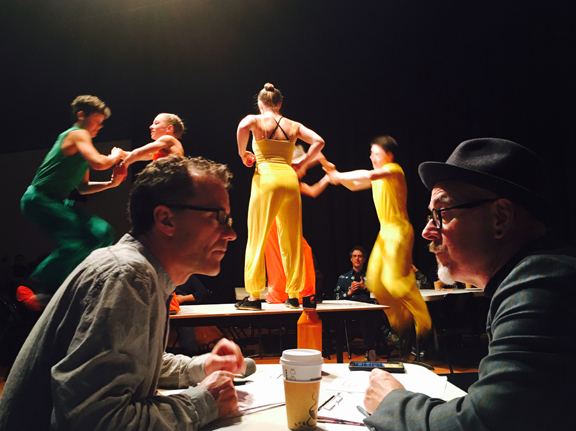 Director David Crellin and MC Kevin Joyce discussing cues while Cirrus perfects their table routine.
