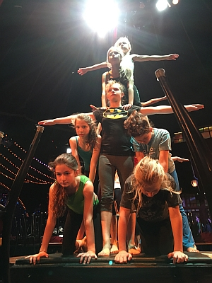 Julaine (center) basing a pyramid of Cirrus Circus acrobats.